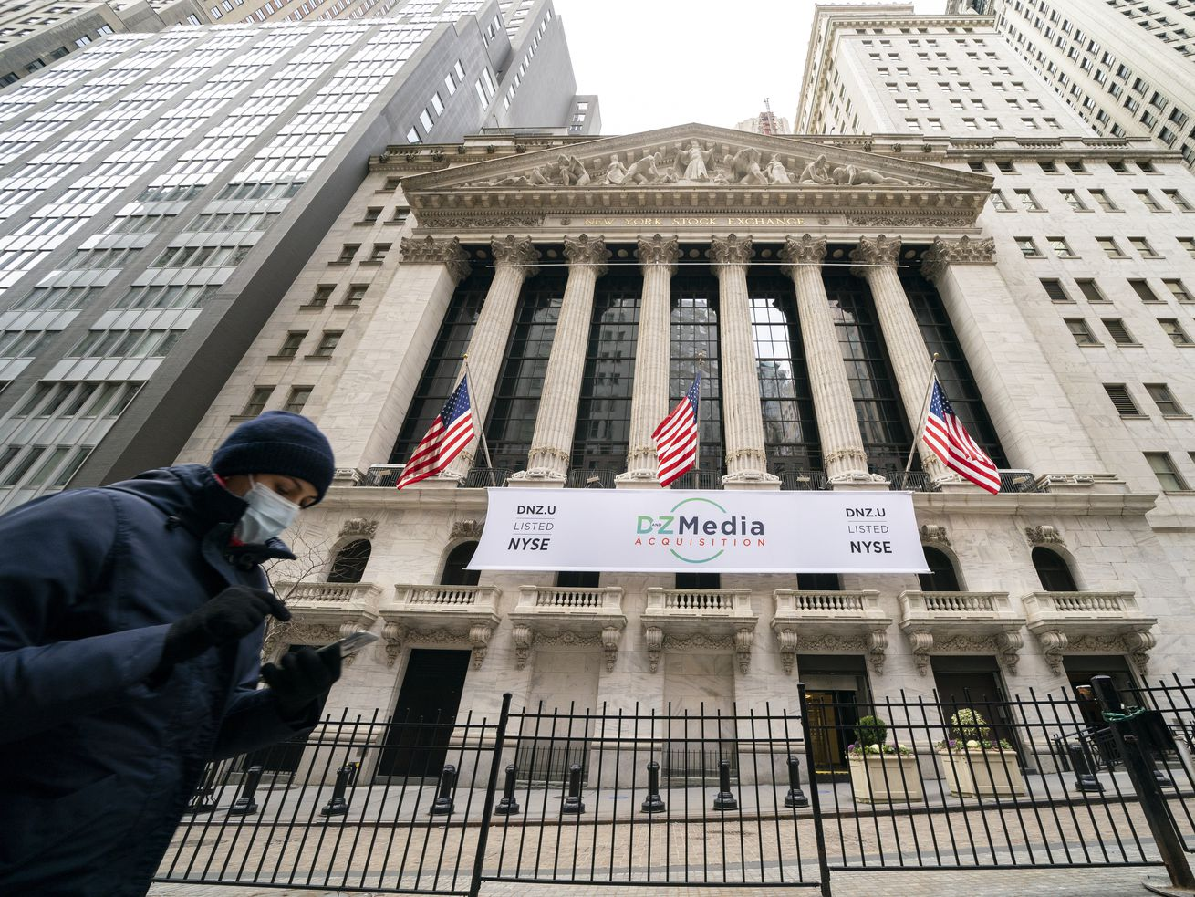 Pedestrians pass the New York Stock Exchange. A huge shift is underway in the stock market that might roil your 401(k) in the short term but that many professional investors see leading to long-lasting gains.