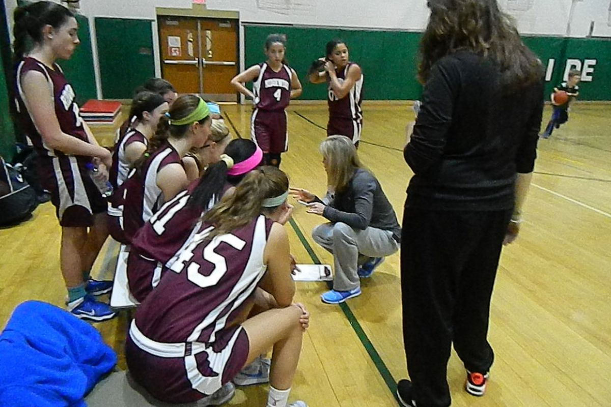 Karen Robinson-Keyes addresses her Ridgewood team during a time out.