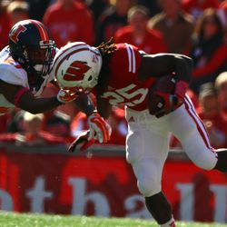 Melvin Gordon is brought down by the face mask by Illinois defensive back Eaton Spence