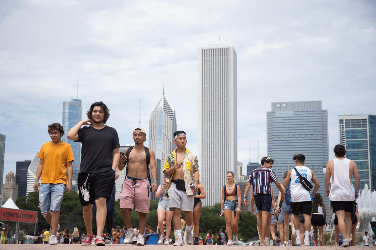 People walk around Grant Park on the second day of Lollapalooza.