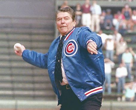 President Ronald Reagan throws out a ceremonial first pitch Sept. 30, 1988, at Wrigley Field before a Pirates-Cubs game. Charles Tasnadi/AP