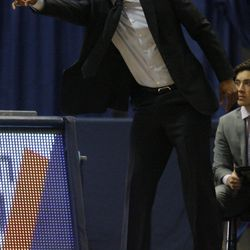 UConn head coach Kevin Ollie yells instructions to his defense.