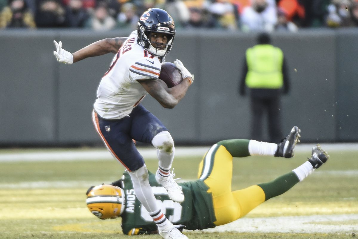 Chicago Bears wide receiver Anthony Miller looks to run after making a catch against Green Bay Packers safety Adrian Amos in the fourth quarter at Lambeau Field.