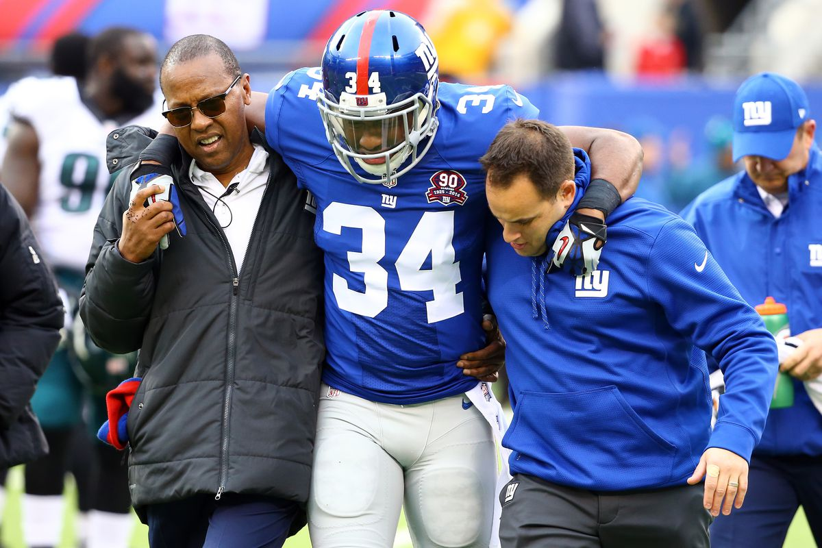 The Giants and injuries too often go together. Here, Nat Berhe is helped off the field during a 2014 game.