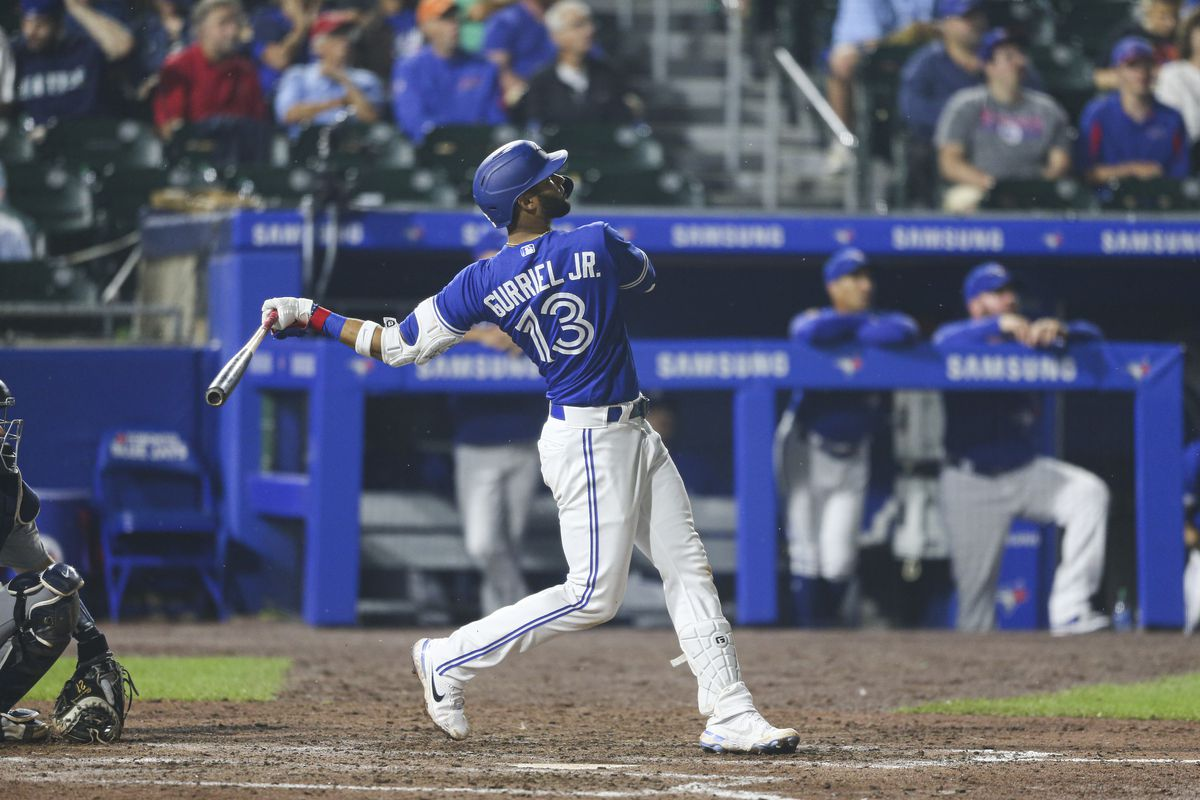 Lourdes Gurriel Jr. #13 of the Toronto Blue Jays hits a home run during the eighth inning against the Seattle Mariners at Sahlen Field on June 30, 2021 in Buffalo, New York.