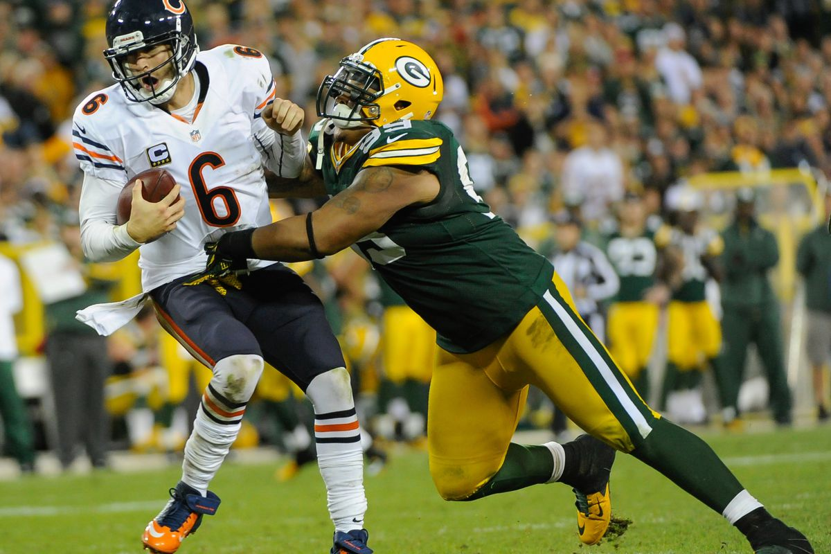 Sept 13, 2012; Green Bay, WI, USA;   Green Bay Packers defensive tackle Jerel Worthy (99) sacks Chicago Bears quarterback Jay Cutler (6) in the fourth quarter at Lambeau Field.  Mandatory Credit: Benny Sieu-US PRESSWIRE