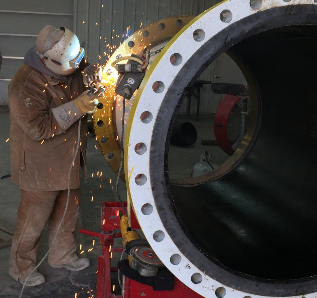 Workers at Foltz Welding prepare a pipe for installation. A bad weld can lead to a leak later on.   Neil Steinberg/Sun-Times