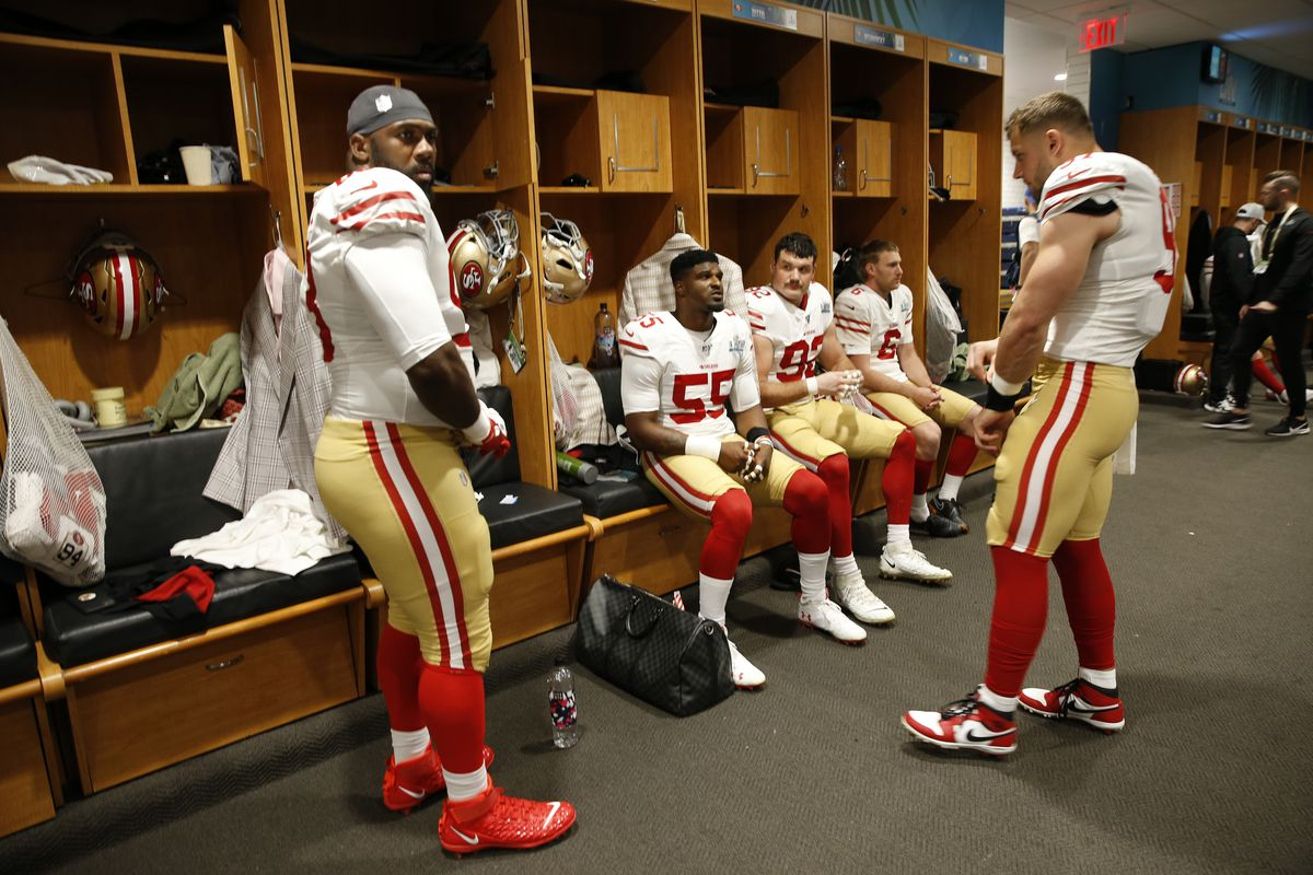 Nick Bosa of the San Francisco 49ers talks with Dee Ford and Anthony Zettel in the locker room before the game against the Kansas City Chiefs in Super Bowl LIV at Hard Rock Stadium on February 2, 2020 in Miami, Florida.