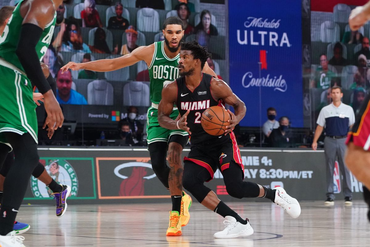 Jimmy Butler of the Miami Heat handles the ball against Jayson Tatum of the Boston Celtics during Game Two of the Eastern Conference Finals of the NBA Playoffs on September 19, 2020 at the AdventHealth Arena at ESPN Wide World Of Sports Complex in Orlando, Florida.