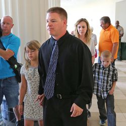 Shaun Cowley, a former West Valley police officer who shot and killed Danielle Willard, 21, in November 2012, leaves his hearing with his family. His attorneys, including Paul Cassell who just joined the case, believe Cowley should never have been charged, Monday, July 28, 2014, in Salt Lake City.