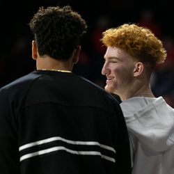 Five-star Arizona commit Nico Mannion, left, jokes to fellow commit Josh Green before the 2018 Red-Blue game in McKale Center on October 14 in Tucson, Ariz.