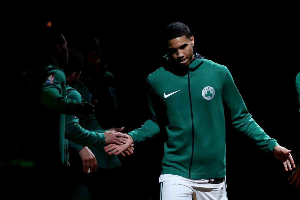 Boston Celtics win seventh straight game, led by Irving and Horford