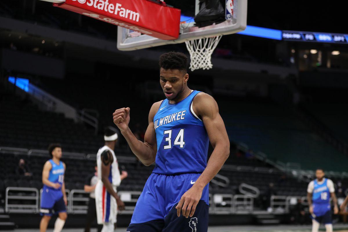 Milwaukee Bucks forward Giannis Antetokounmpo (34) reacts after scoring against the Detroit Pistons at the Bradley Center.