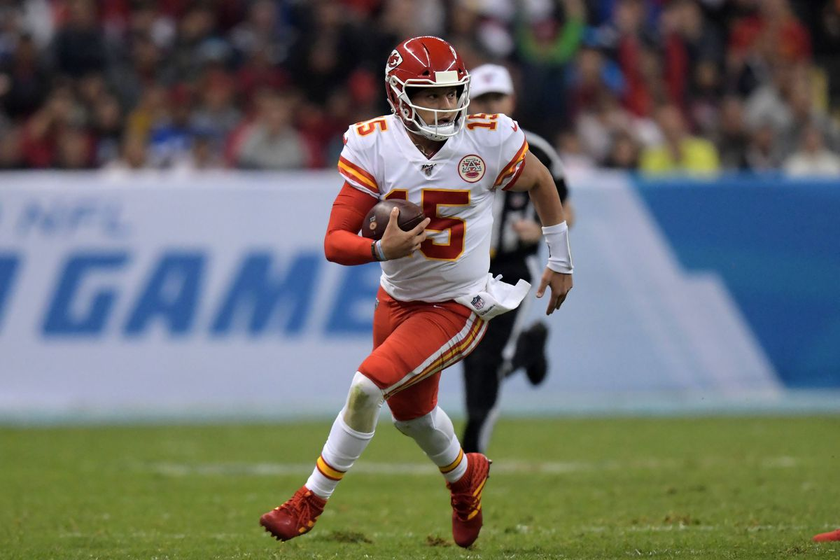 Kansas City Chiefs quarterback Patrick Mahomes carries the ball in the third quarter against the Los Angeles Chargers during an NFL International Series game at Estadio Azteca.