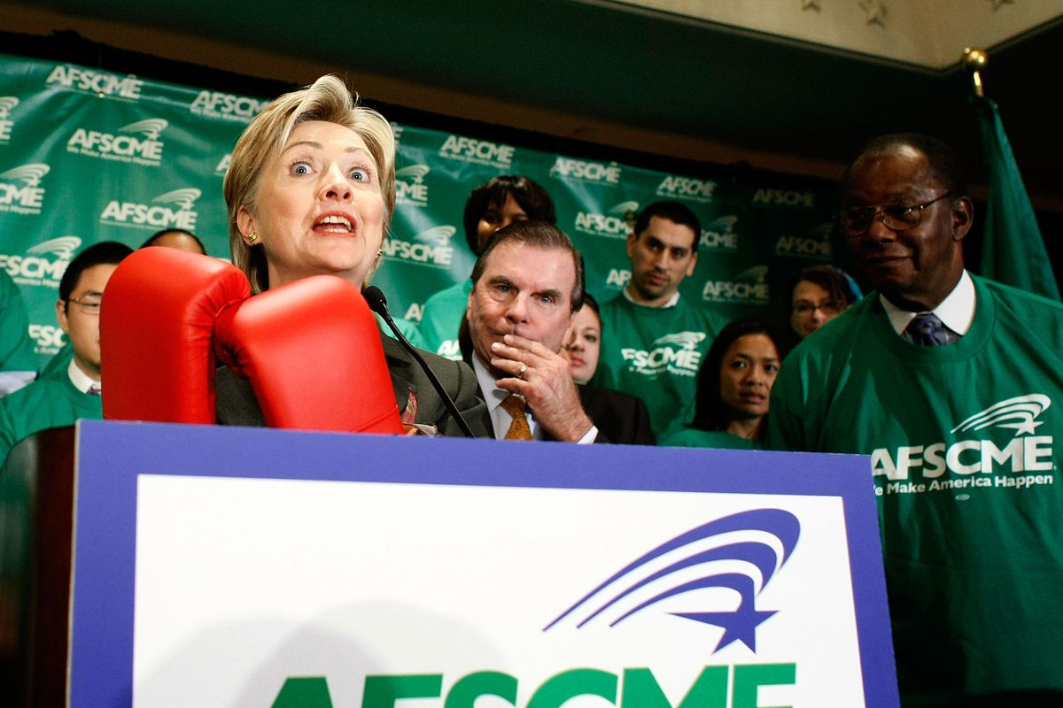 Democratic presidential candidate Hillary Clinton holds up a pair of boxing gloves given to her by a union leader on October 31, 2007, in Washington, DC.