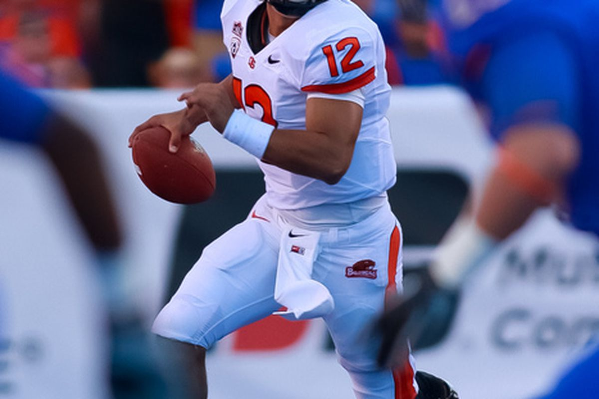 BOISE ID - SEPTEMBER 25:  Quarterback Ryan Katz #12 of the Oregon State Beavers looks for a receiver against the Boise State Broncos at Bronco Stadium on September 25 2010 in Boise Idaho.  (Photo by Otto Kitsinger III/Getty Images)
