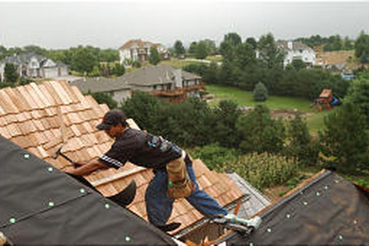 Jorge Miranda roofs a house in Belleview, Neb. Falls are the most common cause of death among Mexican-born workers.