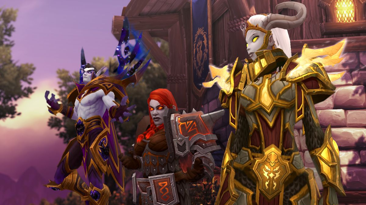 The Alliance allied races stand in front of a banner