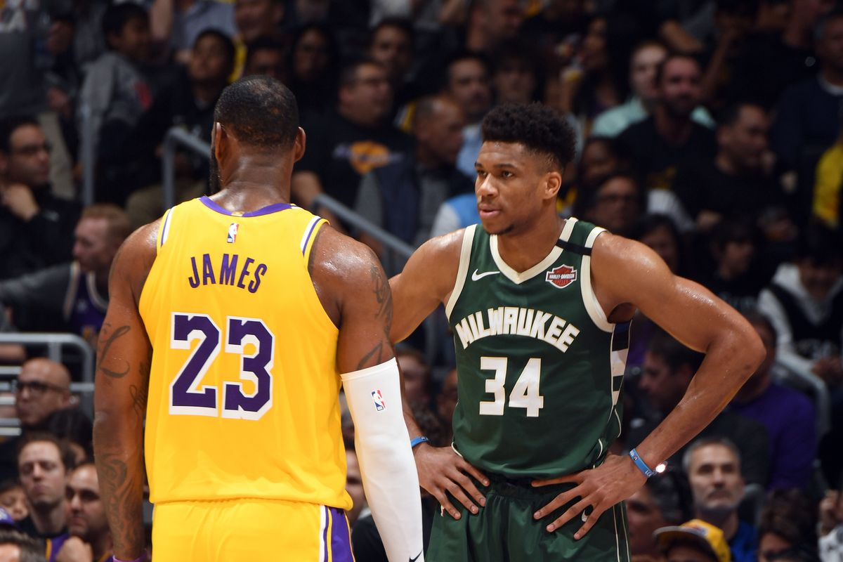 LeBron James of the Los Angeles Lakers and Giannis Antetokounmpo of the Milwaukee Bucks look on during the game on March 6, 2020 at STAPLES Center in Los Angeles, California. NOTE