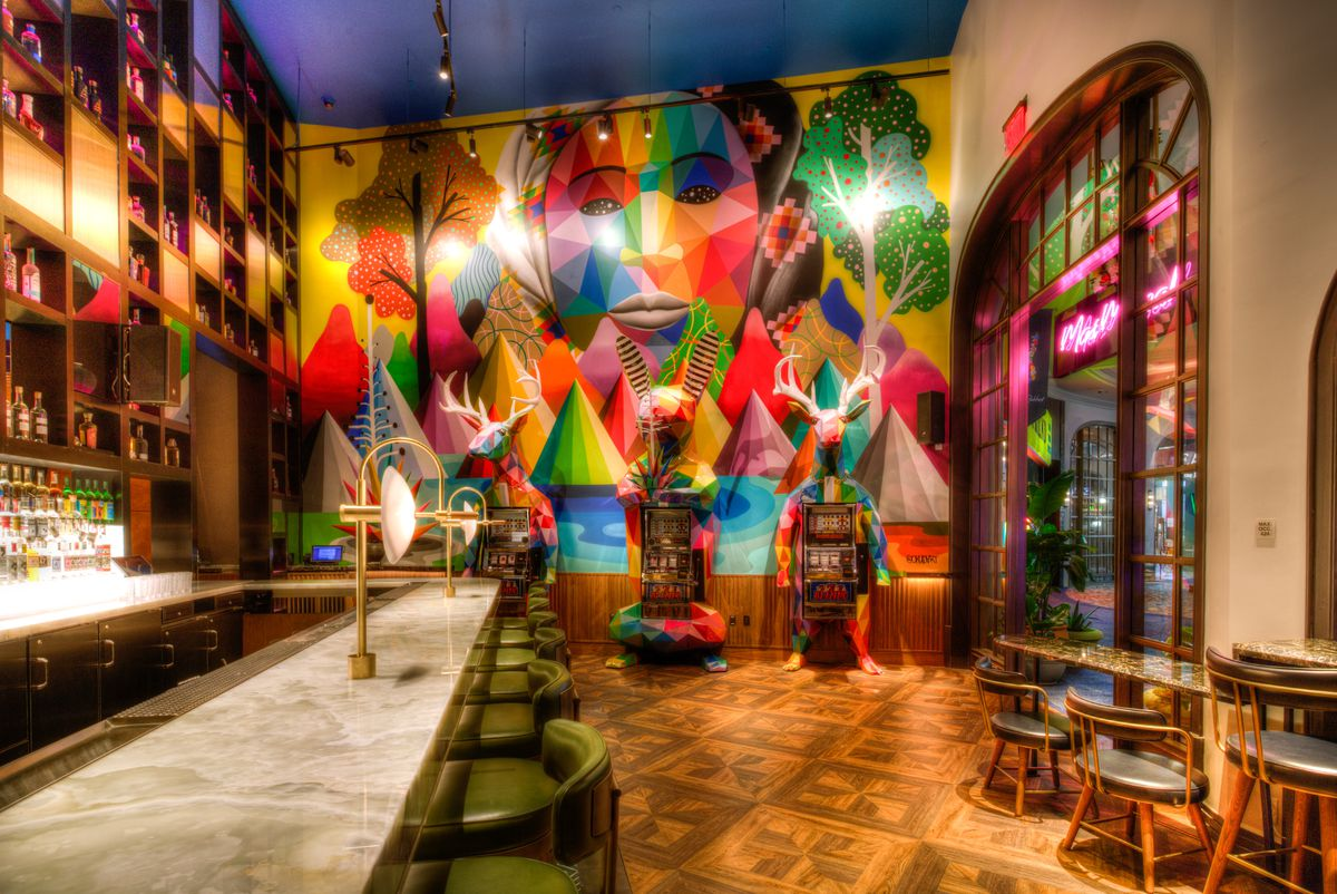 A colorful mural sets the scene at a bar