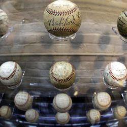 Autographed baseballs, including one signed by Babe Ruth, are on display in the new Royal Rooters Club for season-ticket holders at Fenway Park in Boston Monday, April 9, 2012. The Boston Red Sox baseball home opener is Friday.