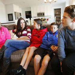 Jenni Thompson talks with her four children Sage, Davin, Cade and Creed at their home in Lehi, Nov 23, 2014. Several Thompson family members, including Jenni's husband, Bryce, have died from cancer.