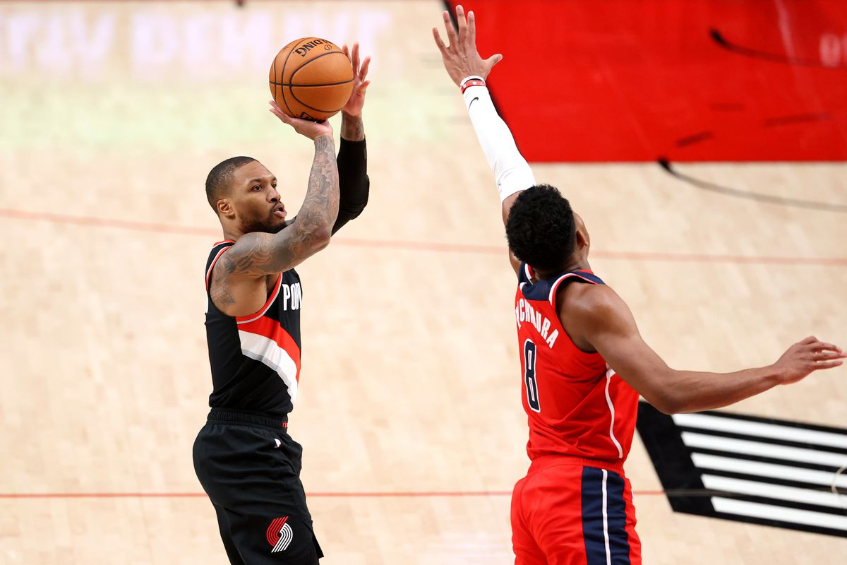 Damian Lillard #0 of the Portland Trail Blazers takes a shot against Rui Hachimura #8 of the Washington Wizards in the third quarter at Moda Center on February 20, 2021 in Portland, Oregon.