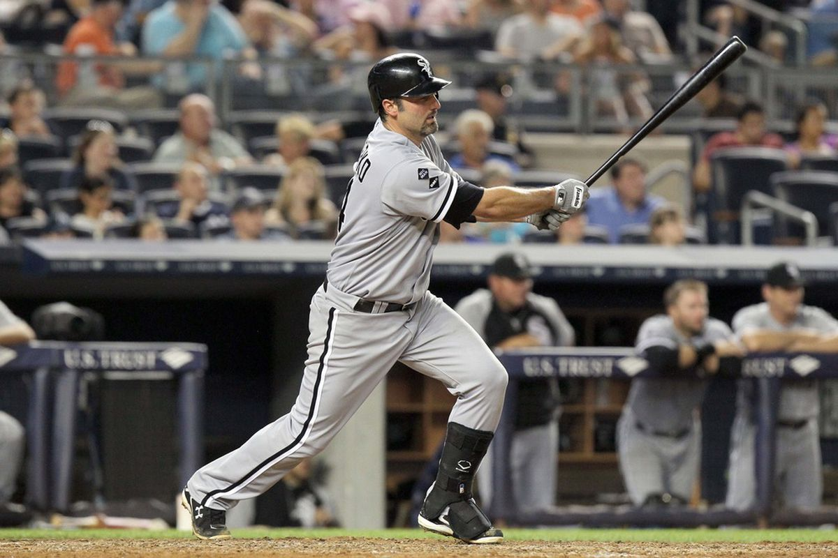 June 29, 2012; Bronx, NY, USA; Chicago White Sox batter Paul Konerko (14) hits a single during the sixth inning of a game against the New York Yankees at Yankee Stadium. Mandatory Credit: Brad Penner-US PRESSWIRE