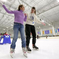 Charlotte Covington skates with her mother, Bonnie Covington, at Peaks Ice Arena in Provo on Wednesday, April 5, 2017.