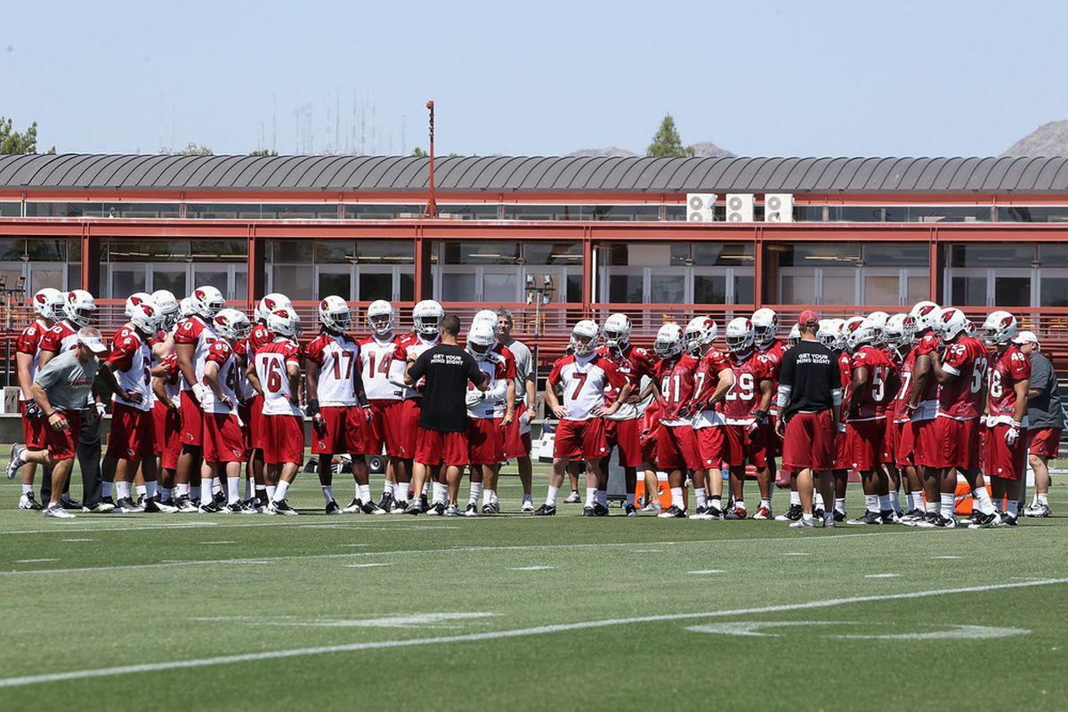 TEMPE, AZ - MAY 11:  The offense and defense of the Arizona Cardinals huddle up in the minicamp at the team's training center facility on May 11, 2012 in Tempe, Arizona.  (Photo by Christian Petersen/Getty Images)