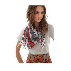 """<a href=""""http://www.lemlem.com/collections/accessories/products/bella-gauze-square-scarf"""">Lemlem Bella Gauze Square Scarf</a> in red, $125"""