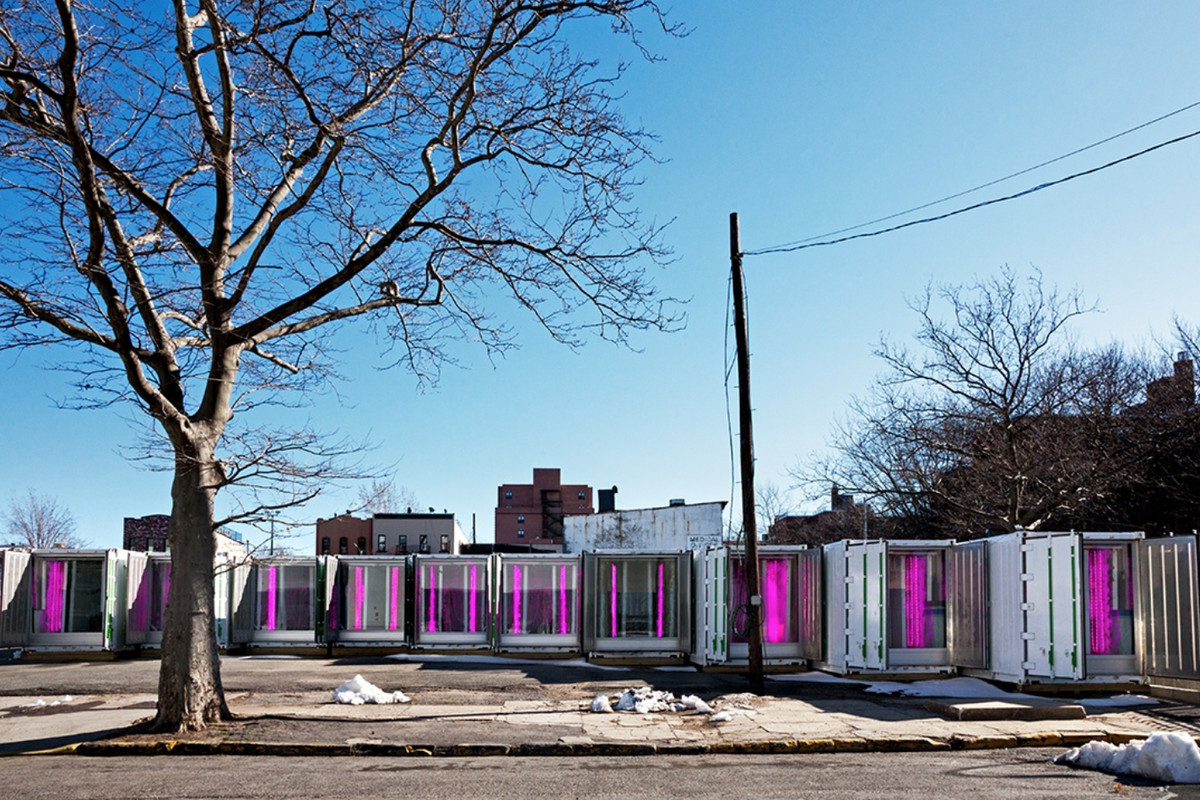 Shipping containers with pink glowing lights