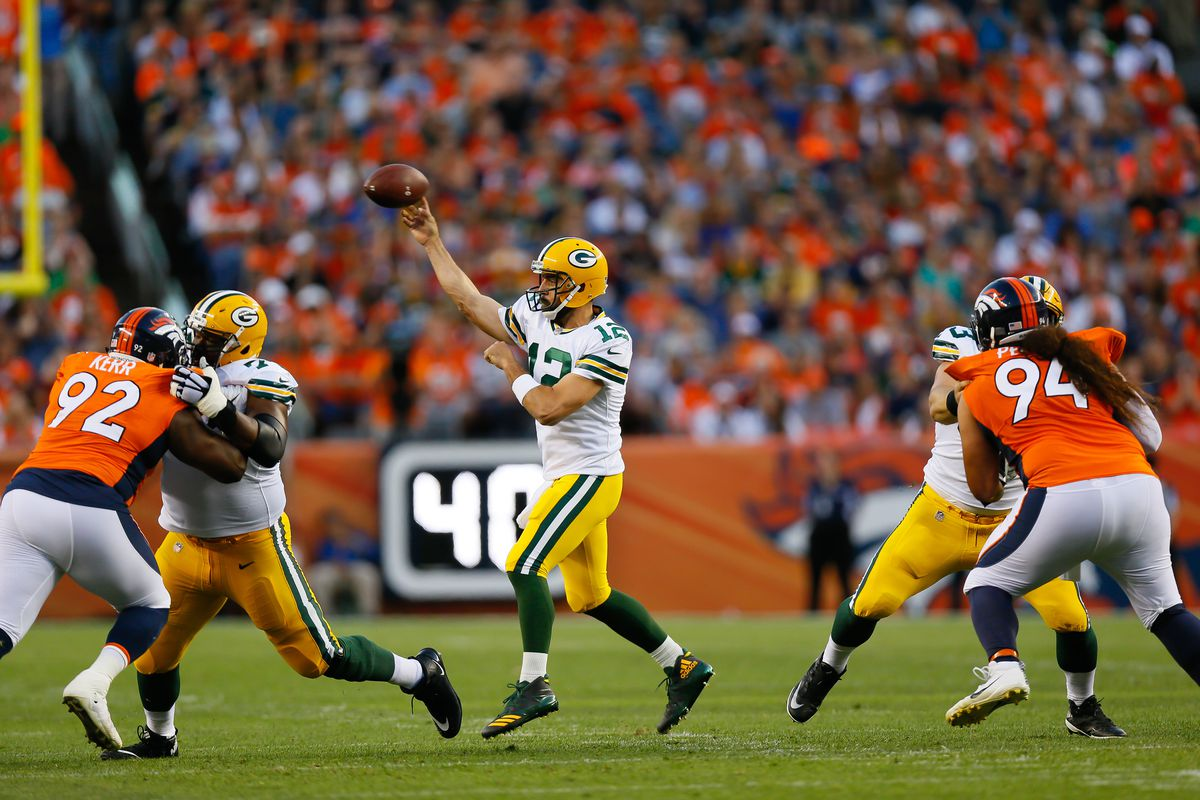 Green Bay quarterback Aaron Rodgers throws a pass in a preseason game against Denver