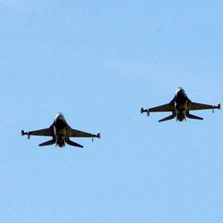 Four F-16 fighters do a fly over as Hill Air Force Base's 34th fighter squadron is inactivated at a ceremony at the base.  Friday, July 16, 2010.