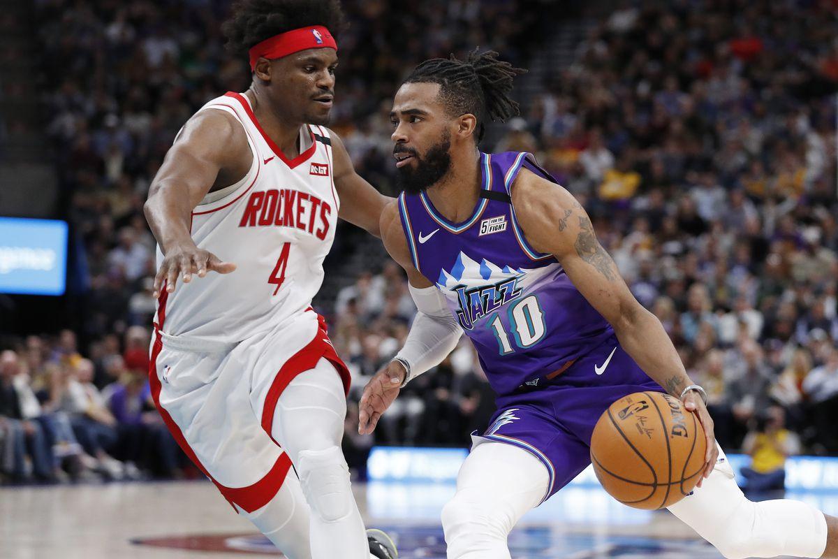 Utah Jazz guard Mike Conley drives against Houston Rockets forward Danuel House Jr. during the fourth quarter at Vivint Smart Home Arena.