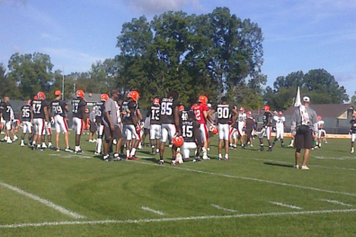 Browns QB Colt McCoy Talks to WR Brian Robiskie during practice.