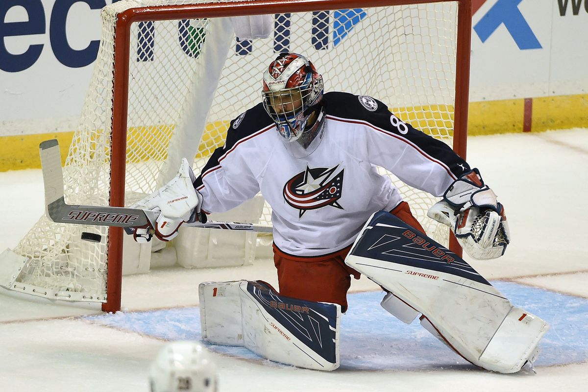 Sep 25, 2016; St. Louis, MO, USA; Columbus Blue Jackets goalie Jeremy Brodeur (80) makes a save against the St. Louis Blues during the third period of a preseason hockey game at Scottrade Center. The Blues won 7-3.