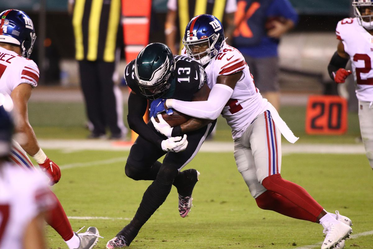 Giants Cornerback James Bradberry (24) tackles Philadelphia Eagles Wide Receiver Travis Fulgham (13) in the first half during the game between the New York Giants and Philadelphia Eagles on October 22, 2020 at Lincoln Financial Field in Philadelphia, PA.