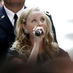 Carmen Rasmusen Herbert sings the national anthem at the swearing-in ceremony for Gary Herbert as the new governor of Utah.