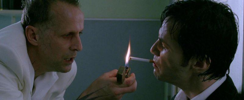 Satan lights a cigarette for Constantine