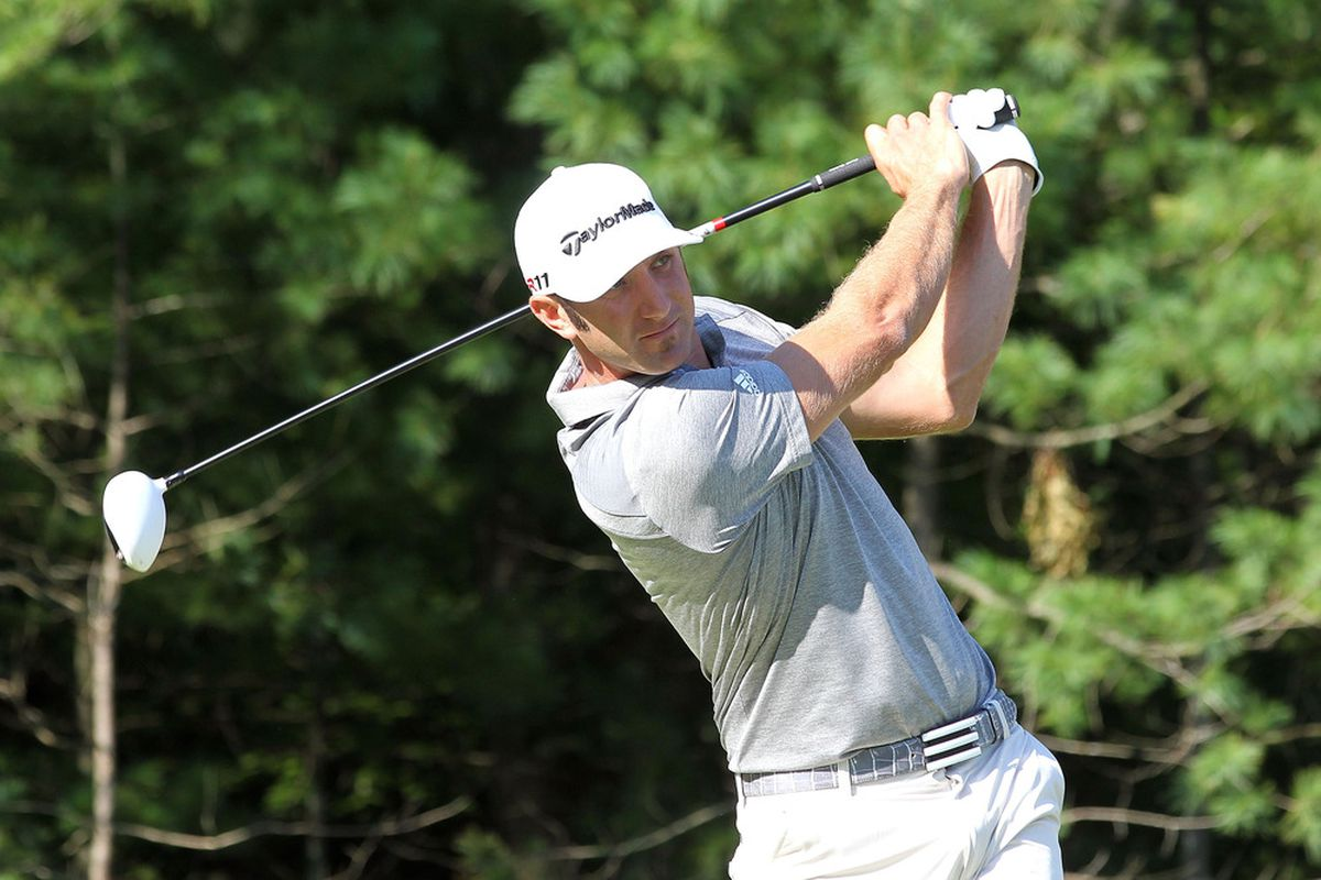 NORTON, MA - SEPTEMBER 02:  Dustin Johnson watches his tee shot on the 15th hole during the first round of the Deutsche Bank Championship at TPC Boston on September 2, 2011 in Norton, Massachusetts.  (Photo by Jim Rogash/Getty Images)