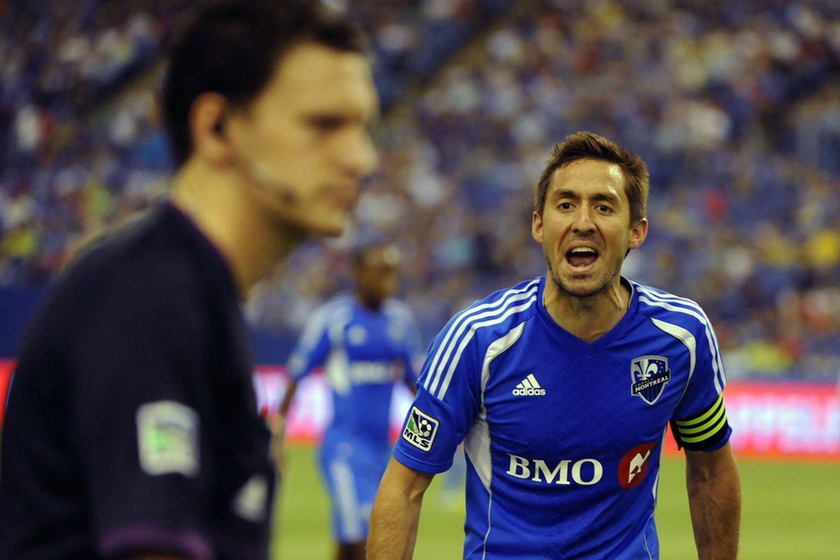 May 19, 2012; Montreal, QC, Canada; Montreal Impact midfielder Davy Arnaud (22) talks to an official  during the first half  of the game against teh New York Red Bulls at the Olympic Stadium.  Mandatory Credit: Eric Bolte-US PRESSWIRE