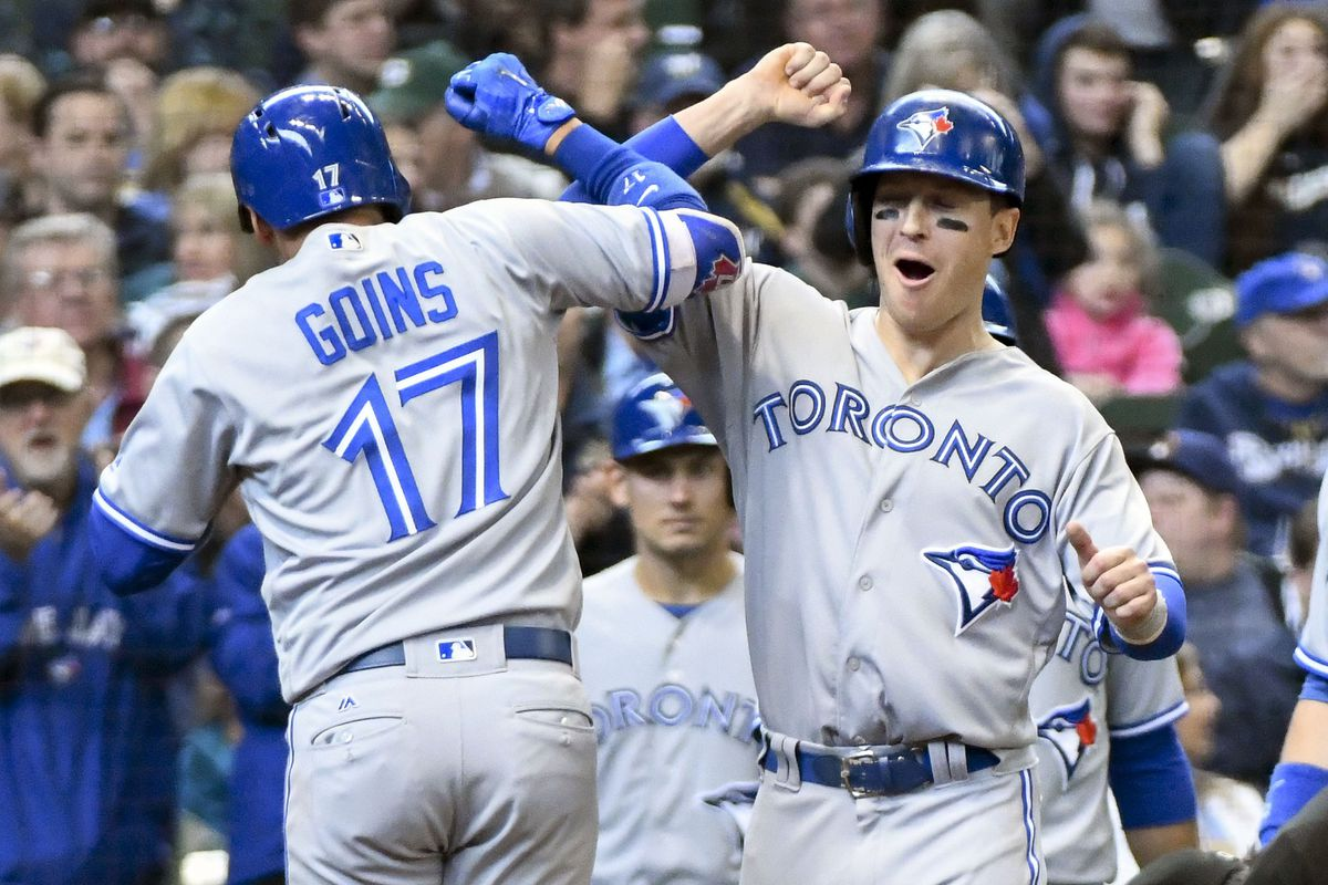 Morales homers, Jays tip Brewers
