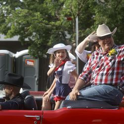 Elder Ronald A. Rasband, a member of the Quorum of the Twelve Apostles for The Church of Jesus Christ of Latter-day Saints, waves as he rides in the Days of '47 Parade in Salt Lake City on Friday, July 23, 2021. Elder Rasband was this year's grand marshal.