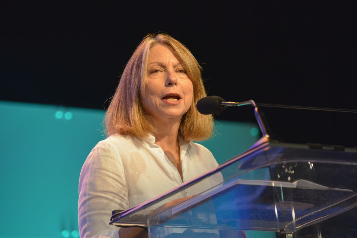 Former New York Times Editor Jill Abramson speaking into a microphone from behind a podium.