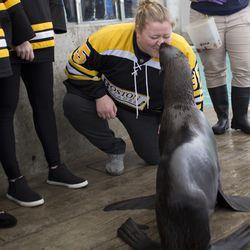 Boston Blades goaltender Lauren Dahm gets a kiss from Ursula.