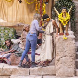 """A woman checks an actor's wardrobe during filming of a faith-based streaming series on the life of Jesus Christ called """"The Chosen"""" at The Church of Jesus Christ of Latter-day Saints' Jerusalem set in Goshen, Utah County, on Monday, Oct. 19, 2020."""