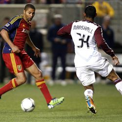 Alvaro Saborio of Real Salt Lake battles for control of the ball against Tyrone Marshall of the Colorado Rapids during their MLS match up at  Rio Tinto Stadium in Sandy Saturday, April 7, 2012.