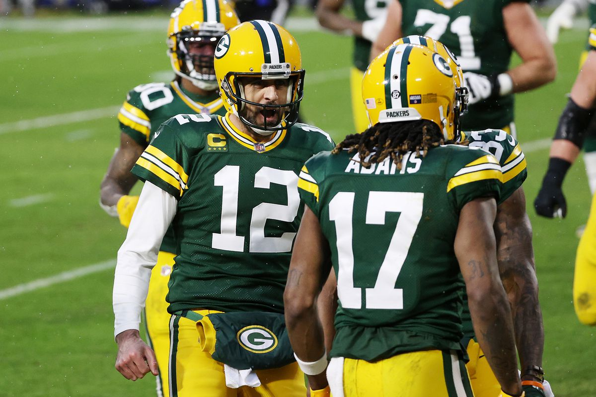 Aaron Rodgers #12 of the Green Bay Packers celebrates throwing a touchdown pass to Davante Adams #17 in the second quarter against the Los Angeles Rams during the NFC Divisional Playoff game at Lambeau Field on January 16, 2021 in Green Bay, Wisconsin.