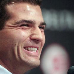 Cincinnati Reds' Joey Votto smiles during a news conference announcing his 12-year deal, Wednesday, April 4, 2012, in Cincinnati. The extension adds 10 years to his previous contract and a club option for 2024. The value of the agreement, the longest guaranteed contract in major league history, is for more than $200 million.